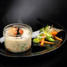 La cassolette de Saint -Jacques, brunoise de légumes sauce suprème aux truffes
